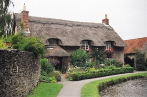 thatched cottage by river